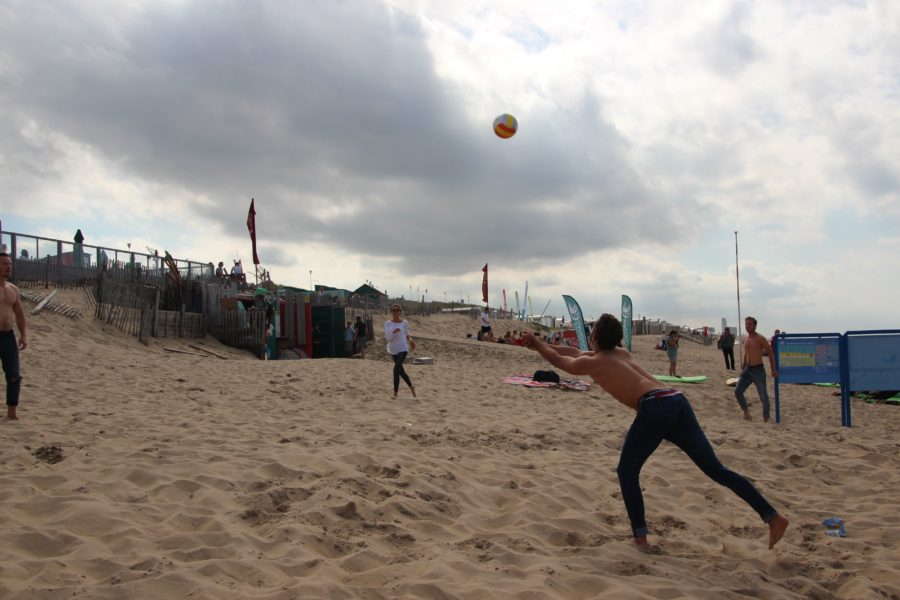 Some Pulse members display their athleticism at a pick up volleyball game on the beach.